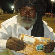 Long after meeting was finished this man was reading his free salvation book.