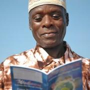 Muslim man reading follow up book.